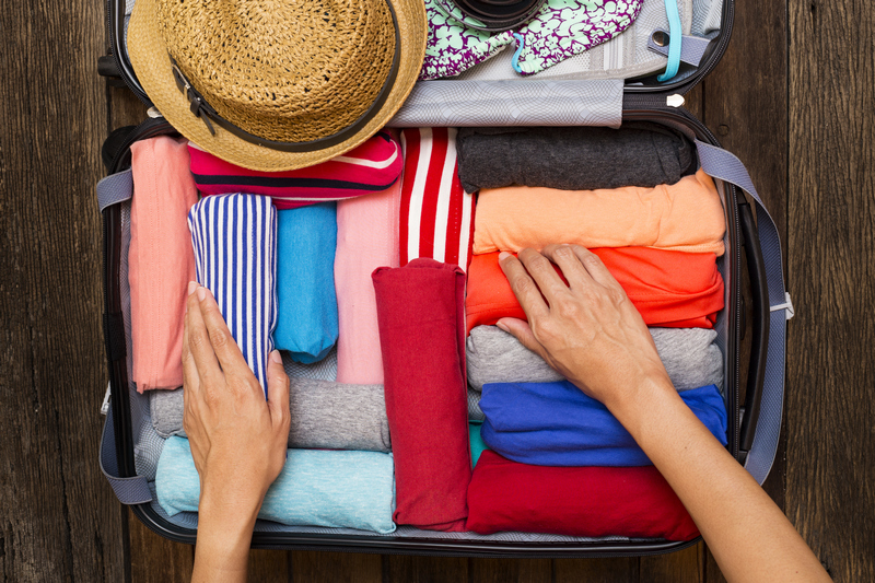clothing being packed into a suitcase - Berlin packing list