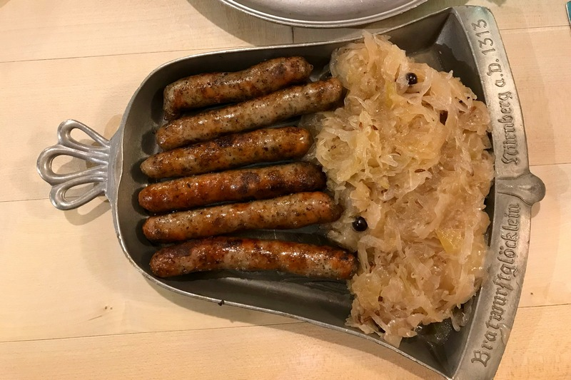 Nuremberg sausages with sauerkraut food to eat in Germany